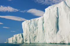 Sun Shining on Glacial Cliffside Royalty Free Stock Image
