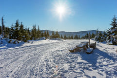 Sun shining with lens flare over snow covered Giant mountains. Czech Republic Stock Photo