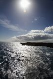 Sun shining on Maui coast. Stock Photos