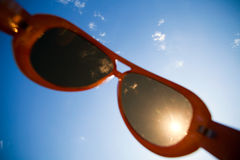 Sun is shining through modern sunglasses Stock Photo