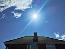 Free Sun Shining On Sky Over The House Royalty Free Stock Photos - 106658638