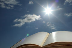 Sun shining on open book Stock Images
