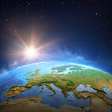 Sun shining over the Earth from space stock illustration