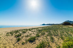 Sun shining over Feraxi beach Royalty Free Stock Photo