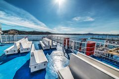Sun shining over a ferry boat in Sardinia Stock Image