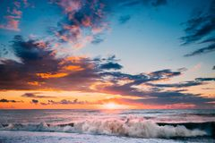 Sun Is Shining Over Horizon At Sunset Or Sunrise. Evening Sea Or. Morning Ocean. Sea Ocean Waves In Colorful Sunset Sunrise Sky Lights. Natural Sky Warm Colors Stock Photos