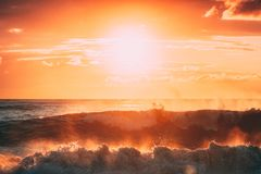 Sun Shining Over Horizon At Sunset Or Sunrise. Evening Sea. Ocean Waves In Warm Colors Sunset Sunrise Sky Lights. Natural Sky royalty free stock photo