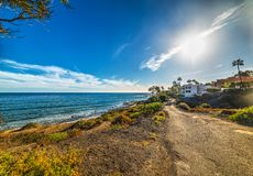Sun shining over Malibu shoreline Stock Image