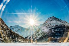 Sun shining over the mountains in Bessans stock photo