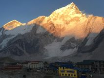 Sun shining over Nuptse mountain, Nepal royalty free stock image