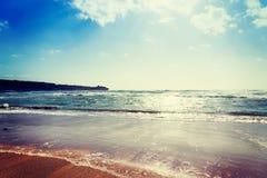 Sun shining over Porto Ferro shore Stock Images