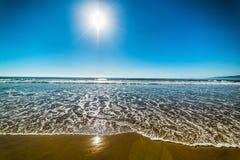 Sun shining over Santa Monica beach. California, USA Stock Photos