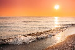 Sun Sea Horizon During Sunset Or Sunrise. Evening Seascape And Tranquil. Sun Shining Over Sea Horizon During Sunset Or Sunrise. Evening Seascape And Tranquil Royalty Free Stock Photography