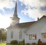 Sun shining over white church Royalty Free Stock Photography