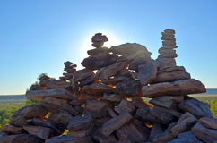 Sun shining through rock cairns Royalty Free Stock Image