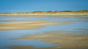 Walking along the Schiermonnikoog coastline on a summerday Netherlands Royalty Free Stock Images