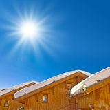 Sun shining, snowy roofs Stock Image