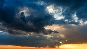 Sun shining through the stormy clouds. God rays, sky background stock images