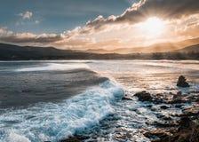 Sun shining on stormy seas at Lozari beach in Corsica Stock Photos