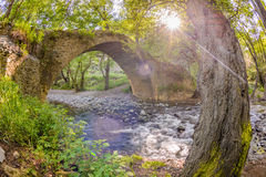 The sun shining through the trees at  kelefos bridge,cyprus,4 Royalty Free Stock Images