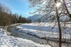 River running through a snow landscape near Flachau Austria royalty free stock photos