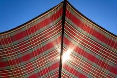 Sun shining through umbrella Royalty Free Stock Photography
