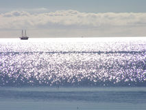 Sun shining on water. The sun is shining pearls on the ocean Royalty Free Stock Photos