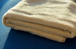 Sun shining on  yellow bath towels Stock Photos