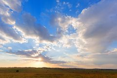 Sun shinning through the clouds. At Rietvlei NR, South Africa Royalty Free Stock Images