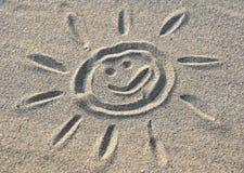 Sun sign in sand Stock Photos