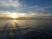 The sun sinks in the sea royalty free stock image
