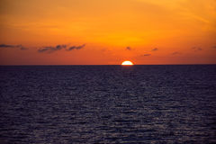Sun Sinks Into the Sea Stock Images