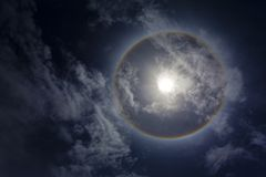 Sun with sircular rainbow and clouds Royalty Free Stock Image