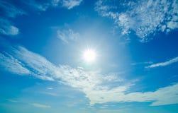 Sun with skies and cloud Stock Photos