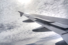 Sun, sky and airplane wing Royalty Free Stock Photography