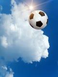 Sun sky ball. Flying football against the solar sky royalty free stock image
