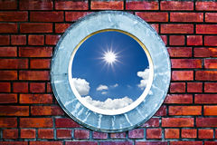 Sun and sky behind wall. Bright sun cloud and blue sky behind wall royalty free stock photography