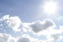 Sun in sky. Bright sun shining in clouds Royalty Free Stock Photography