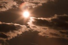 Sun, sky and clouds Stock Photos