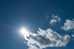 Sun in the sky and clouds. Stock Images