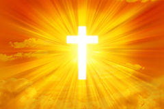 Sun Sky and Cross Background. A glowing cross in a warm sunny sky background Royalty Free Stock Photography