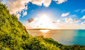 Sun sky sea and clouds and cliffs Royalty Free Stock Photos