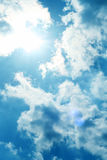 Sun in the Sky. The sun shines in the sky with clouds Royalty Free Stock Photos