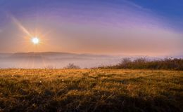 Sun on the sky. View on the mountain and sun, blue orange Stock Image