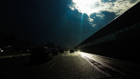 Sun in the sky and water on the road Royalty Free Stock Photography