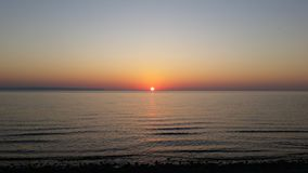 Beach sunset. Sun sky water sand view Royalty Free Stock Image
