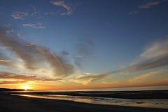 Sunrise over the Sea of Cortez, El Golfo, Mexico. Sun slowly climbing at el golfo de santa clara, Sonora, Mexico. Brilliant Orange, yellow, blues, sea, ocean stock images