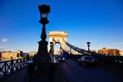 The Széchenyi Chain Bridge in Budapest, Hungary. The sun slowly sets on the Széchenyi Chain Bridge in Budapest, Hungary royalty free stock photo