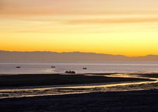 Dusk settling over the Sea of Cortez, El Golfo, Mexico. Sun slowly setting at el golfo de santa clara, Sonora, Mexico. Brilliant Orange, yellow, blues, sea royalty free stock photo