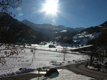 Sun and Snow in Lenk, Switzerland. A view of the landescape and sun,  outside of Lenk, Switzerland in the winter Royalty Free Stock Photos